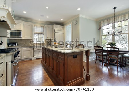 Kitchen With Center Island kitchen with center island and eating area stock photo 70741150