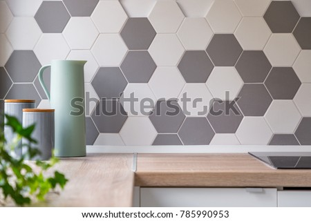 Kitchen with grey and white honeycomb wall tiles and wooden worktop, - Shutterstock ID 785990953