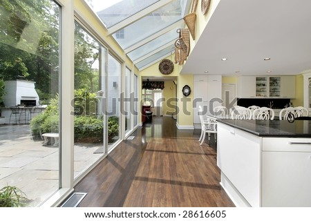 Kitchen with hallway and outside patio view