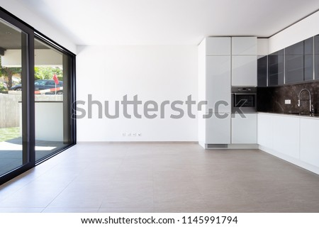 Kitchen with large window overlooking the garden. Nobody inside