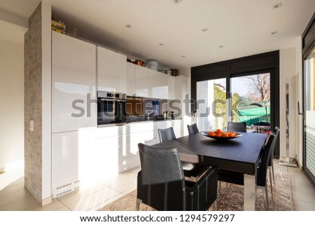 Kitchen with leather table and chairs in modern apartment. Nobody inside