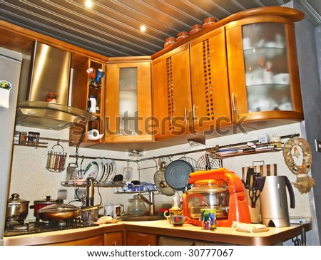 kitchen with utensils and appliances - stock photo