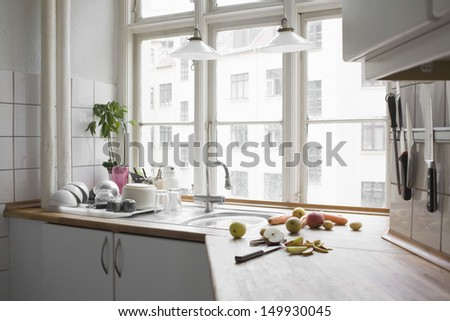 Kitchen worktop with chopped fruit and vegetables in urban apartment