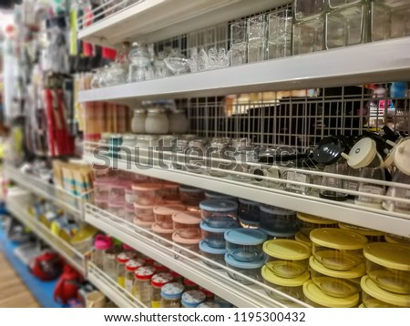 Kitchenware display shelf in supermarket. Various of products for household and kitchen tool. #1195300432