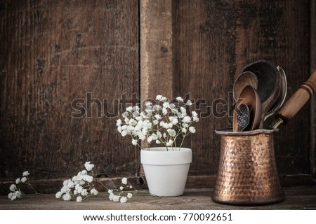 Kitchenware on the old wooden background #770092651