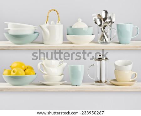 Kitchenware on wooden shelves