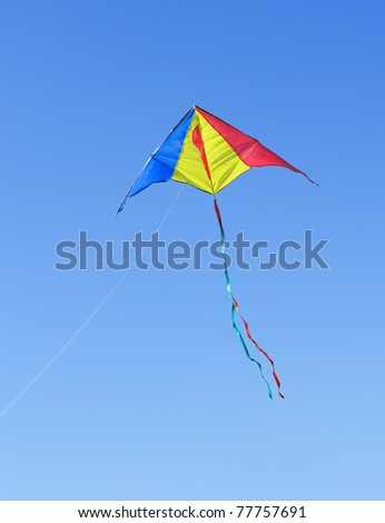 Kite against the blue sky. Symbol of dreams and happiness