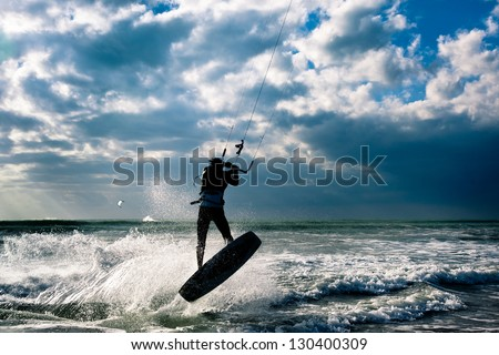 KITE BOARDING. Kite surfer jumping.