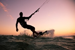 Kite boarding. Kitesurf freestyle at sunset.