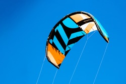 kite filled with the wind against a blue sky background