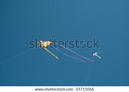 Kite in the shape of flying dragon on the blue sky background