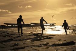 Kite surfer at sunset