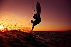 Kite surfing at sunset.