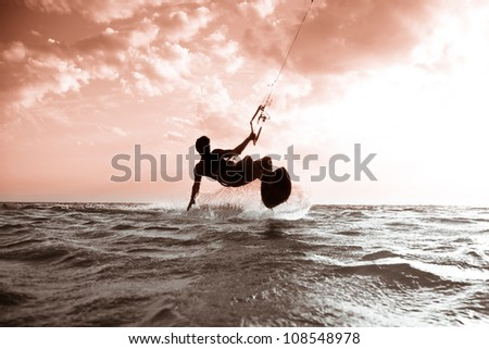 Kite surfing at sunset.