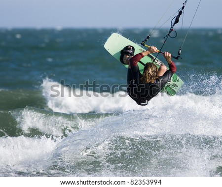 Kite surfing in Dorset. A kite surfer rides the waves.