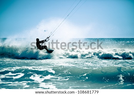 Kite surfing in waves. Splash