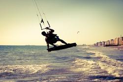 Kite surfing near the city of Cadiz, southern Spain. Vintage