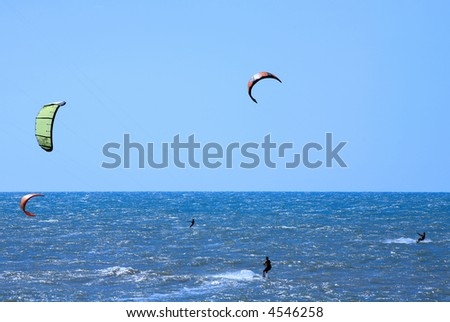 Kite surfing on cumbuco beach near fortaleza in brazil - stock photo