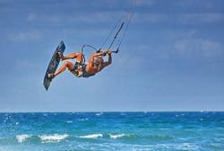 kiteboarder athlete performing kiteboarding kitesurfing tricks unhooked