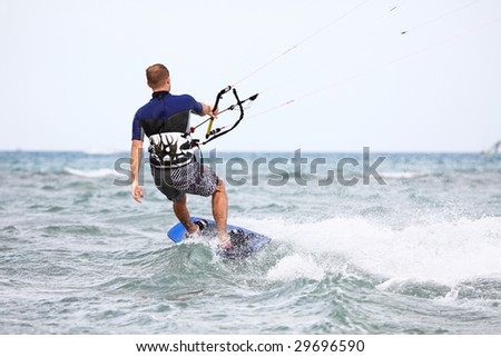 Kiteboarder enjoy surfing in blue water