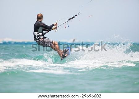 Kiteboarder enjoy surfing in blue water
