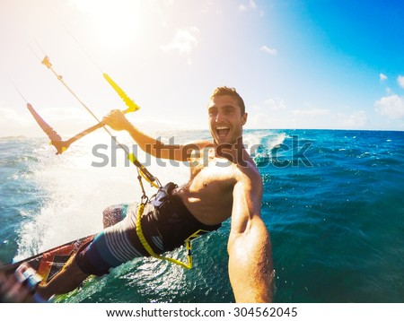 Stock Photo Kiteboarding. Fun in the ocean, Extreme Sport Kitesurfing. POV Angle with Action Camera