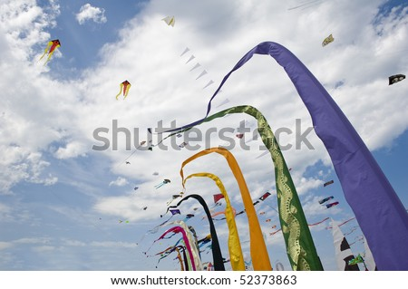 Kites flags and banners on beach. Cervia International Kite Festival, Italy.