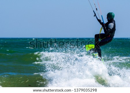 Kitesurfer in action #1379035298