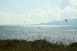 Kitesurfing and windsurfing in Trabucador beach, in Ebre Delta. Amposta, Catalonia
