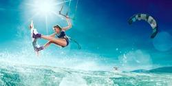 Kitesurfing. Girl rides a kite
