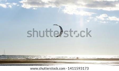 Kitesurfing kites in the sand of Castelldelfels beach, Barcelona, Catalunya, Spain, Europe #1411593173