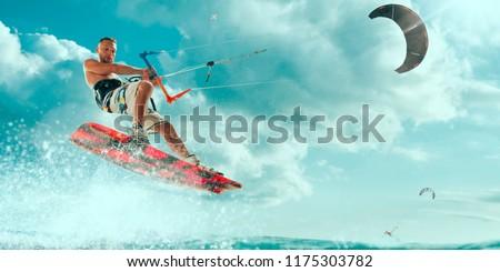 Photo of  Kitesurfing. Man rides a kite