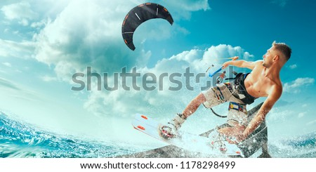 Photo of  Kitesurfing. Man rides on kite on waves