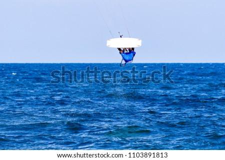 Kitesurfing on the waves of the sea in Mui Ne beach, Phan Thiet, Binh Thuan, Vietnam. Kitesurfing, Kiteboarding action photos