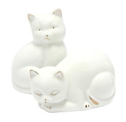 Kitsch white porcelain kitten figurines isolated on white background