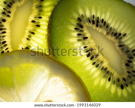kiwi and lemon wedges  Makro close up  Photographed on a backlit light table Stock foto ©