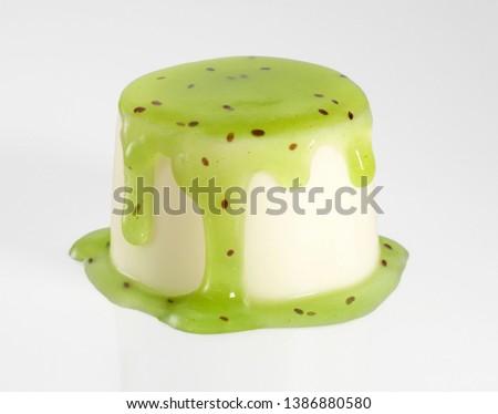 Kiwi custard with kiwi jam and kiwi coulis on a white background #1386880580