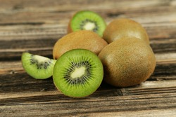 Kiwi fruit on brown wooden background