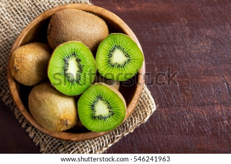 Kiwi fruit on wooden background with copy space #546241963