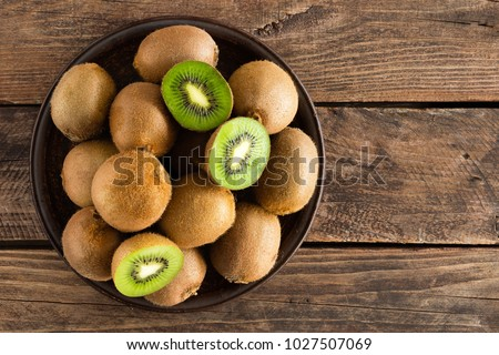 Kiwi fruit on wooden rustic table, ingredient for detox smoothie #1027507069