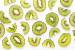 Kiwi fruit Slices macro. Ripe Kiwi fruit isolated on white background. flat lay.Fresh tropical abstract background.
