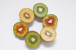 Kiwi Fruits in three different colors: Red Kiwi, Gold Kiwi and Green Kiwi isolated on white background.