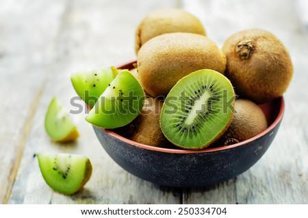 kiwi on white wood background. tinting. selective focus Zdjęcia stock ©