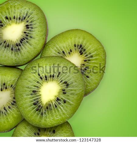 Kiwi slices on green background