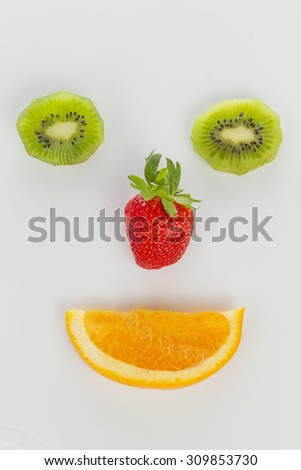 kiwi, strawberry and orange in the shape of the face #309853730