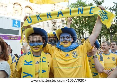 KKIEV, UKRAINE - 11 JUNE: Football fans from Ukraine  are in Fan-Zone of  EURO 2012   June, 11, 2012 in Kiev.