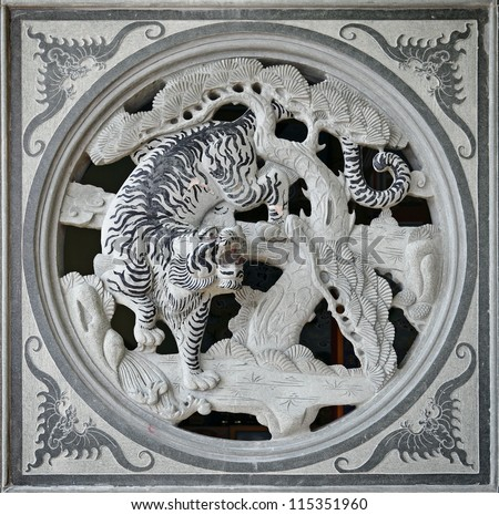 KLANG, MALAYSIA - SEPTEMBER 16: Facade of a granite stone carving of a tiger which is the third symbol in the Chinese horoscope in the Kuan Yin Buddhist Temple on September 16, 2012 in Klang, Malaysia