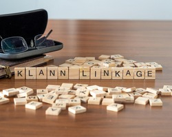 klann linkage concept represented by wooden letter tiles