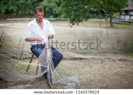 KLUKI, POLAND - AUGUST 10, 2018: Museum of Slovinic Countryside - the oldest part of Kluki with wattle and daub thatched cottages as 19th-century Slovinic fishing village #1160378824