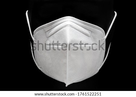 KN95 or FFP2 Face mask isolated on black background. Protection against Coronavirus Covid-19. Front view